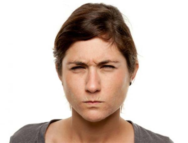 woman meanly squinting and pursing lips