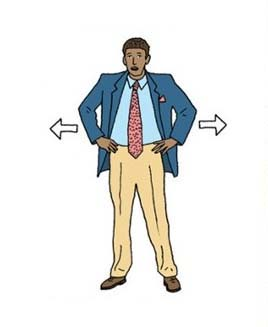 a person with hands on hips, spread legs and chest out to appear threatening