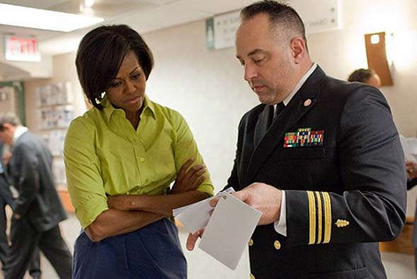 photo of Michelle Obama talking to military man