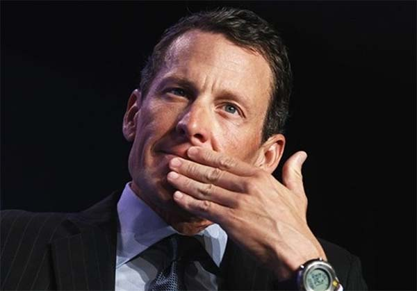 photo of Lance Armstrong covering mouth